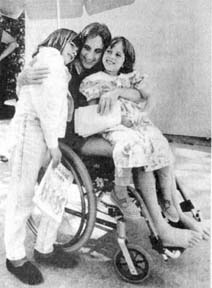 Judi Bari in wheelchair at convalescent care home visits with her daughters Lisa and Jessie. 1990 photo by David J. Cross.