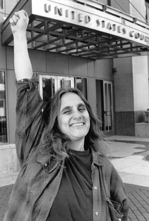 Judi Bari , always defiant, raises her fist in front of the Oakland Federal Building, 1995